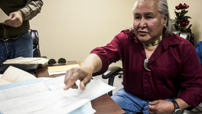 Bill Sitting Chief points to documents he will use to help the Little Shell Tribe gain federal recognition Tuesday.