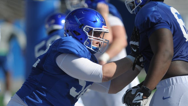 C Drake Jackson blocks during the UK spring football practice at Commonwealth Stadium in Lexington, Ky., on Saturday, March 26th, 2016.
