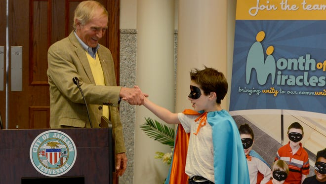 Jackson City Mayor Jerry Gist shakes hands with Miracle Man Elisha Gaugh at the fourth annual Month of Miracles kickoff Friday at City Hall.