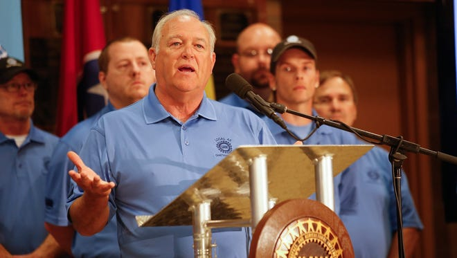 UAW President Dennis Williams speaks during a news conference held Thursday, July 10, 2014, at the IBEW Local 175 in Chattanooga, Tenn., to announce the formation of a new local United Auto Workers' union in Chattanooga for Volkswagen workers. (AP Photo/Chattanooga Times Free Press, Doug Strickland)