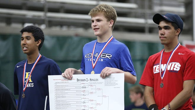 Kohler's Casey Johnson (center) stands atop the award's poddium after winning the WIAA Division 2 State Singles title on Saturday.