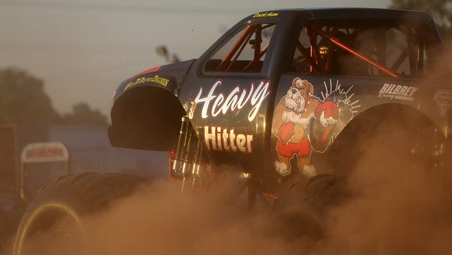 Dust flies up from the Heavy Hitter moster truck during the 45th Annual Budweiser Championship Tractor & Truck Pull & Battle of the Monster Trucks at Jackson Fairgrounds Park on Friday, June 10, 2016.