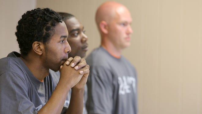 Blake Carroll, left, Cedric Kinnie and AJ Greenway look on Thursday during their graduation from the Inside/Out program at the Madison County Penal Farm.