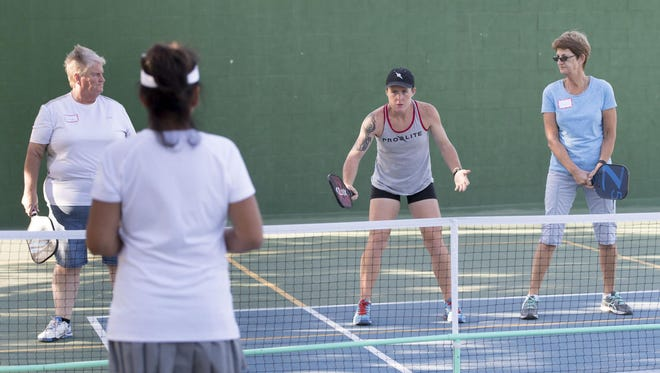 National Pickleball champion Sarah Ansboury, center, works with local players at Plaza Park in Visalia on Wednesday, June 15, 2016