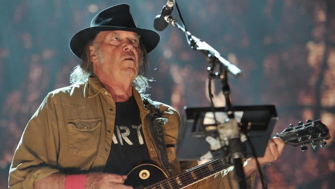 """Neil Young recently release the live album """"Earth."""""""