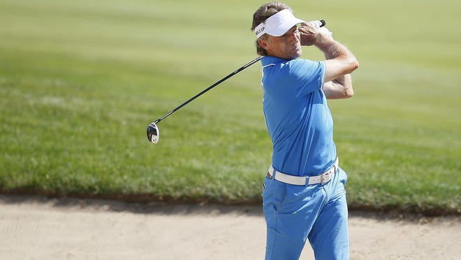 Bernhard Langer hits on the ninth green at the first round of the inaugural PGA American Family Insurance Championship.