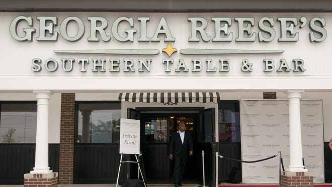 Owner and former Indianapolis Colts linebacker Gary Brackett walks through the doors of one of his Georgia Reese's Southern Table & Bar restaurants.