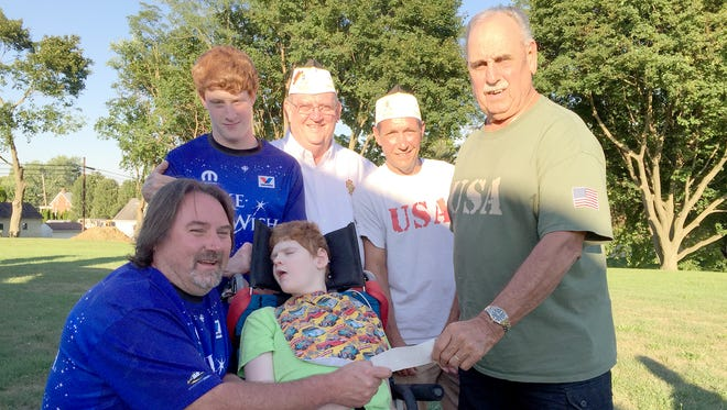 "Front row, from left, are: Darrin Boecael ""Crusin to Grant Wishes"" Chairman and dad to Joey, Joey Boecael and Larry Chronister, car show chairman; back row: Nash Boecael, Darrin's helper; Dwight Fuhrman, Dept. of PA Sr. Vice Commander and Quartermaster of VFW Post 8896; and Tony Groft, Commander VFW Post 8896."