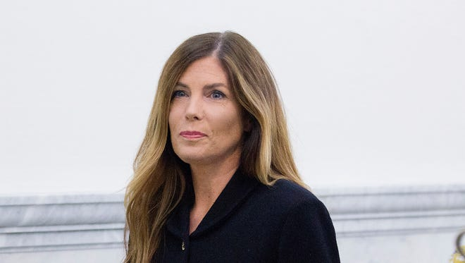 Pennsylvania Attorney General Kathleen Kane walks down a hall at the Montgomery County Courthouse, Monday in Norristown, Pa. She was convicted Monday by a jury after her perjury and obstruction trial.