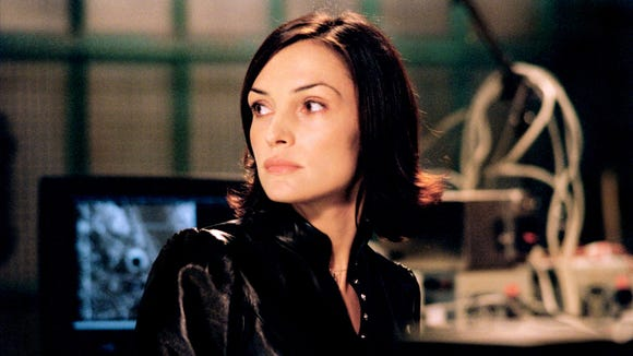 "Famke Janssen stars as undercover agent Rachel Wright in the motion picture ""I Spy."""
