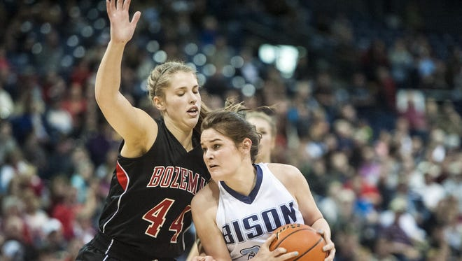 Emma Madsen, then a junior, drives to the basket against Bozeman in the 2016 State AA championship game.