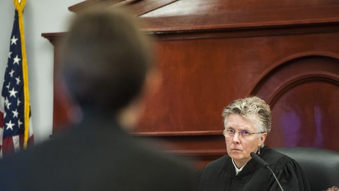 Judge Elizabeth Best speaks to a deputy attorney during initial appearances in the Cascade County Courthouse on Thursday. House Bill 44, if approved, would add two judges in Billings, and one for each district in Missoula, Kalispell and Great Falls.