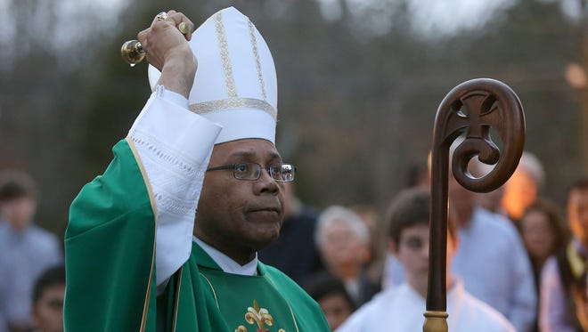 The Most Rev. Martin D. Holley sprinkles the Most Sacred Heart of Jesus statue with Holy Water at Sacred Heart Catholic Church in Humboldt on Saturday, Feb. 4, 2017.