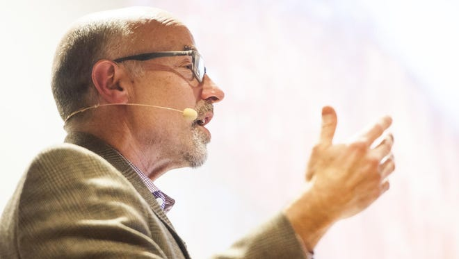 """Larry Abramson, dean of the University of Montana School of Journalism, responds to audience questions during his presentation, """"Media Coverage of the 2016 Presidential Campaign,"""" at Great Falls College MSU on Thursday evening."""