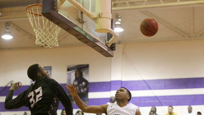 South Side's Kamron Rose (32) blocks a shot by Haywood's Dedric Boyd (20) during a Class AA sectional game at Haywood High School in Brownsville on Monday.