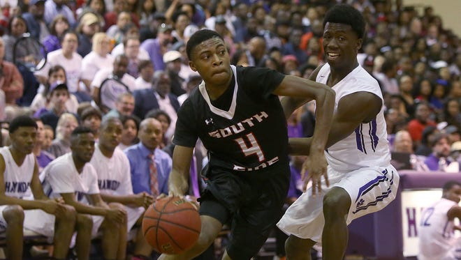South Side's Bryce McBride (4) drives against Haywood's Xavier Walker (1) during a Class AA sectional game at Haywood High School in Brownsville, Tenn., on Monday, March 6, 2017.