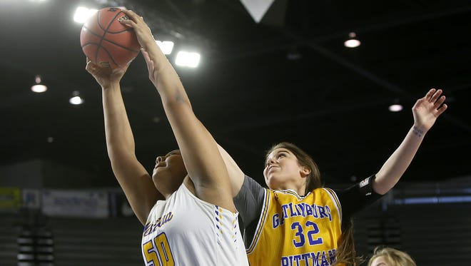 Westview's Raegan Johnson (50) pulls in a rebound against Kennedy Smith (32) and Gatlinburg-Pittman during the TSSAA Class AA state quarterfinals at the Murphy Center in Murfreesboro, Tenn., on Thursday, March 9, 2017.