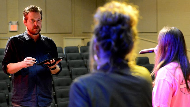 In this file photo from 2017, University of Memphis Lambuth Music Education professor Dr. Jeremy Tubbs listens to his students sing to fix the sound levels during the students' rehearsal for a concert.