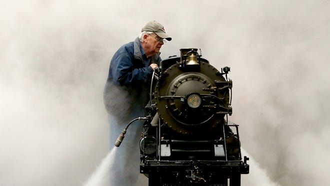 Kitsap Live Steamers member Don Deffley is enveloped in steam as he performs a boiler blowdown on his Mikado locomotive at South Kitsap Regional Park in Port Orchard on Saturday, April 8, 2017.