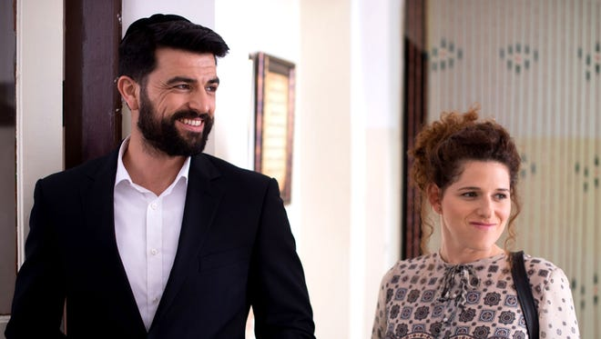"""A woman named Michal is scheduled to get married in 30 days. The problem? Her fiancé has abandoned her. She refuses to cancel the big day, believing God will find her a groom. Noa Koler and Amos Tamam star in """"The Wedding Plan."""" ."""