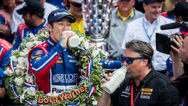 Andretti Autosport driver Takuma Sato (26) celebrates with Michael Andretti after winning the 101st Indy 500 at the Indianapolis Motor Speedway Sunday, May 28, 2017.
