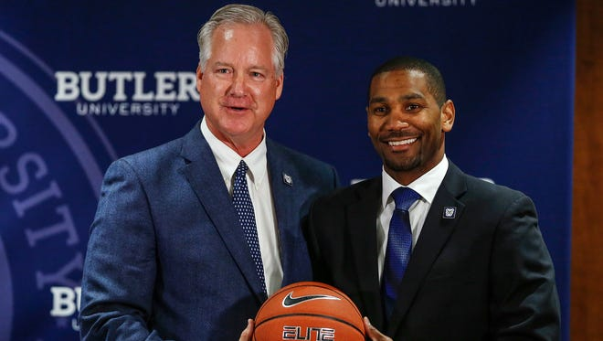 Barry Collier, left, vice president and director of athletics at Butler University, introduces LaVall Jordan as the Butler men's basketball coach at Hinkle Fieldhouse on Wednesday, June 14, 2017.