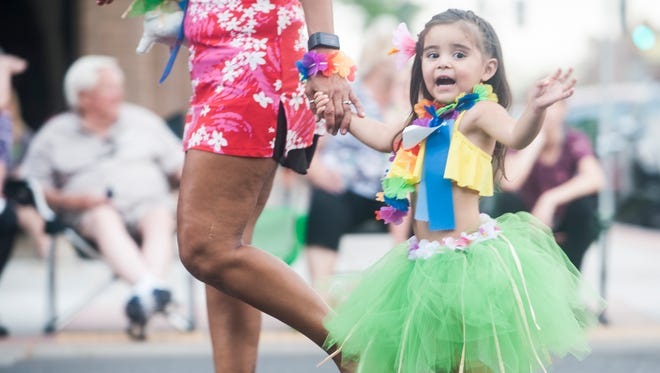 Participants show off clever outfits and adorable pets during the 83rd annual Pet and Doll Parade down Central Avenue Thursday, July 27. This year the parade was beach party themed.