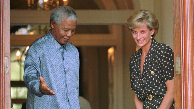 South African President Nelson Mandela, left, meets with Princess Diana in March 1997 to discuss the threat of AIDS in Capetown.