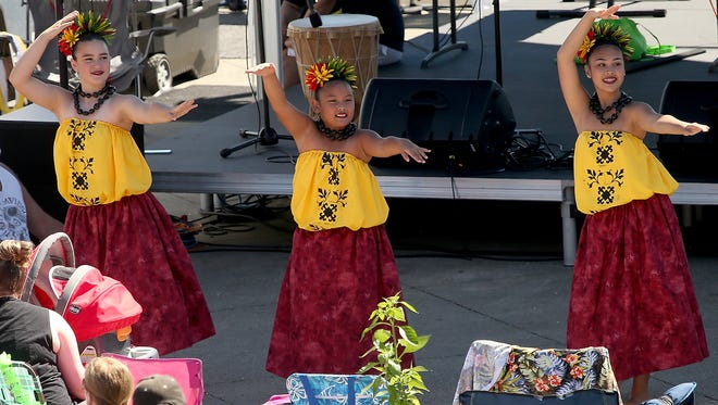 A trio of Hula Halau O Na Mele O Hawaii dancers entertain the crowd during the Pacific Islander Festival at the Bremerton Waterfront on Saturday, August 26, 2017.