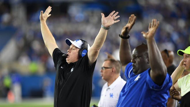 UK head coach Mark Stoops calls to his team during the University of Kentucky football game against University of Florida in Lexington, KY on Saturday, September 23, 2017.