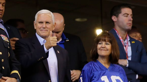 Vice President Mike Pence reacts to fans before an