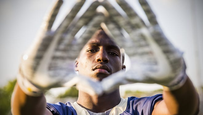 Cathedral WR Daijon Collins balances homework and football, or else he doesn't play.
