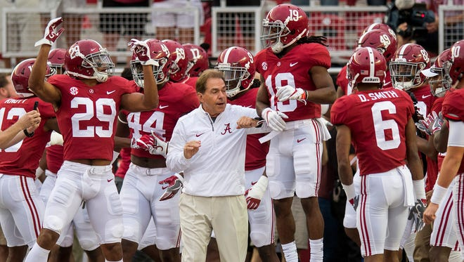 Alabama head coach Nick Saban and his players prepare to take the field for warmups before the Arkansas game at Bryant Denny Stadium in Tuscaloosa, Ala. on Saturday October 14, 2017. (Mickey Welsh / Montgomery Advertiser)