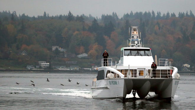 The Kitsap Transit fast ferry Rich Passage 1, arrives for the 8 a.m. sailing to Seattle on a gray Wednesday morning.