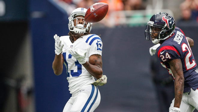 Indianapolis Colts wide receiver T.Y. Hilton (13) pulls in a touchdown pass from quarterback Jacoby Brissett (7) early in the first quarter against the Houston Texans at NRG Stadium in Houston on Sunday, Nov. 5, 2017.