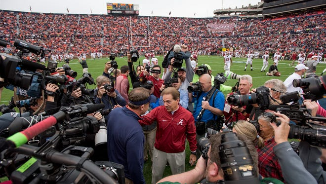 Auburn head coach Gus Malzahn (left) and Nick Saban (right) shake hands before the start of the 2017 Iron Bowl at Jordan-Hare Stadium.