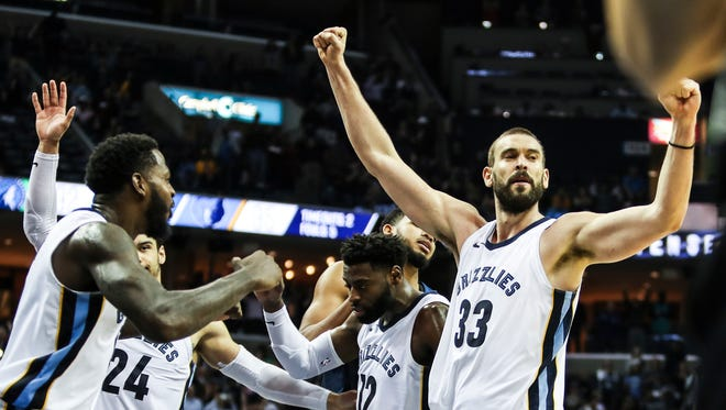 The Grizzlies celebrate their victory over the Timberwolves on Monday at FedExForum.