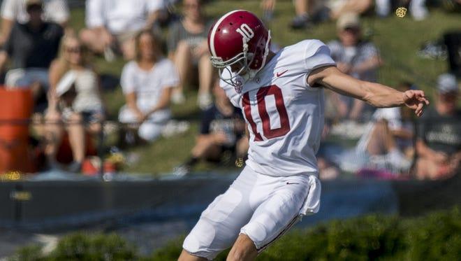 Alabama kicker JK Scott (10) kicks off at Vanderbilt Stadium in Nashville, Tenn. on Saturday September 23, 2017.