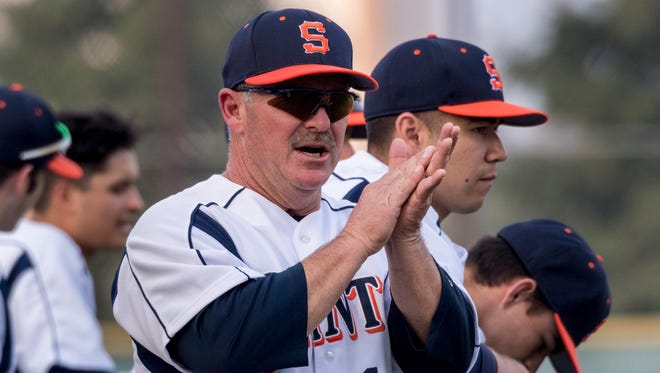 In this file photo, College of the Sequoias' Head Coach Jody Allen encourages his players.