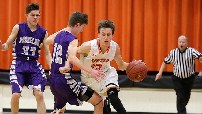 Oakfield High School boys basketball's Tyler Screeter drives past Dodgeland's Derek Antholt during their game in Oakfield Friday, February 2, 2018. Doug Raflik/USA TODAY NETWORK-Wisconsin