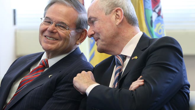 Senator Bob Menendez and Governor Phil Murphy chat in Hackensack, Monday, February 5, 2018.  Both men were at the Democratic Committee of Bergen County to support Jim Tedesco (not shown), who is running for re-election.