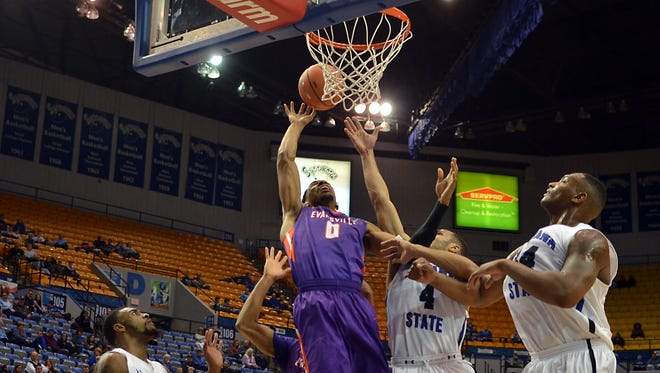 Evansville's Ryan Taylor drives against the Indiana State defense in the first half of the Purple Aces' 58-53 loss on Wednesday in Terre Haute.