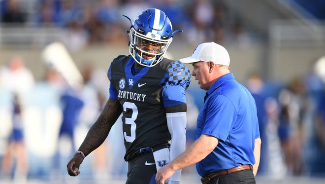 UK QB Terry Wilson talks with head coach Mark Stoops during the University of Kentucky spring football Blue-White scrimmage in Lexington, KY on Friday, April 13, 2018.