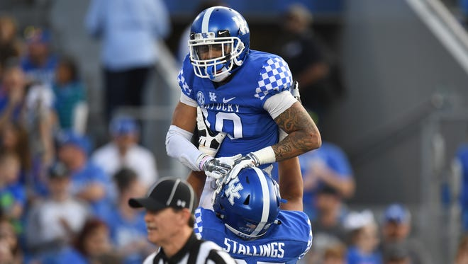 "UK RB Asim ""A.J."" Rose celebrates a touchdown run during the University of Kentucky spring football Blue-White scrimmage in Lexington, KY on Friday, April 13, 2018."
