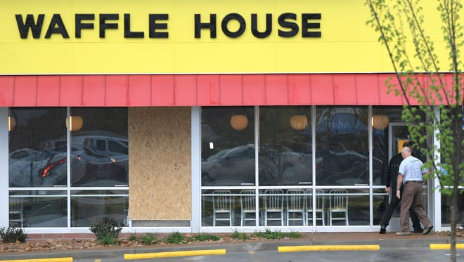 A window is boarded up at the Waffle House in Antioch, Tenn., which remained closed Monday, April 23, 2018, a day after four people were shot and killed by a gunman early Sunday morning.