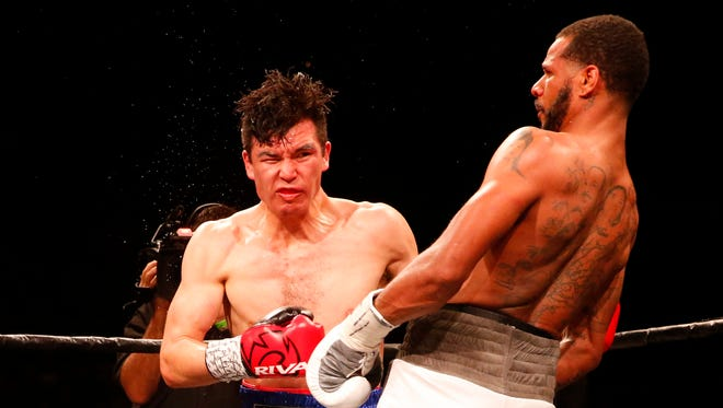 Abie Han takes a vicious upper cut from Anthony Dirrell during an early round in their ten round fight Saturday night at the Don Haskins Center. Dirrell would go on to win the fight by a unanimous decision.
