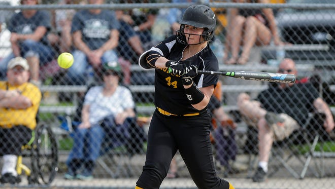 Waupun's Kylie Hraban swings at a pitch against Kewauskum on May 8 in Waupun.