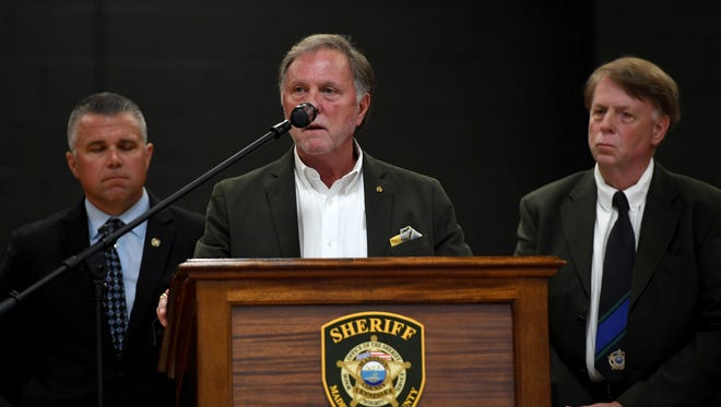 Madison County Mayor Jimmy Harris reads a joint proclamation as Jackson Police Chief Julian Wiser and Madison County Sheriff John Mehr stand behind him during a local ceremony for National Peace Officers Memorial Day, Tuesday, May 15.
