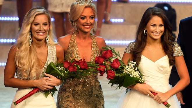 Miss Lexington Madison Snipes and Miss Gallatin Samantha Havenstrite take the stage after being named Thursday night preliminary talent and fitness wear winners respectively, at the 2018 Miss Tennessee Scholarship Pageant, Thursday, June 21.