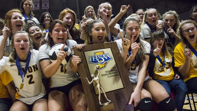 The Avon Orioles girls volleyball team celebrates after defeating Crown Point in the IHSAA Class 4A volleyball state finals at Worthen Arena on the Ball State University campus on Saturday, Nov. 4, 2017. Avon swept Crown Point in three straight sets.